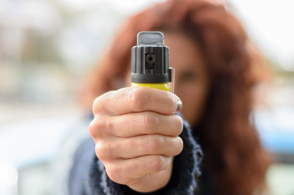 woman pointing pepper spray