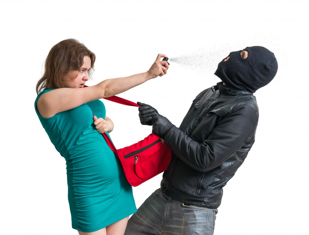 woman using pepper spray