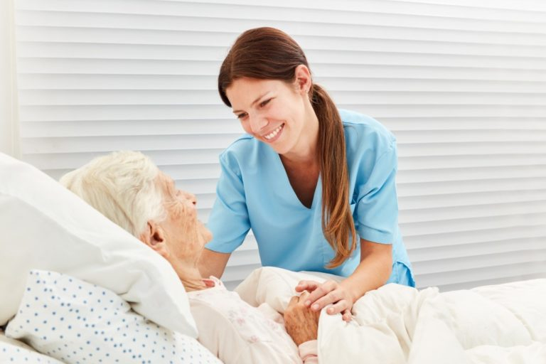 Female nurse caring for elderly