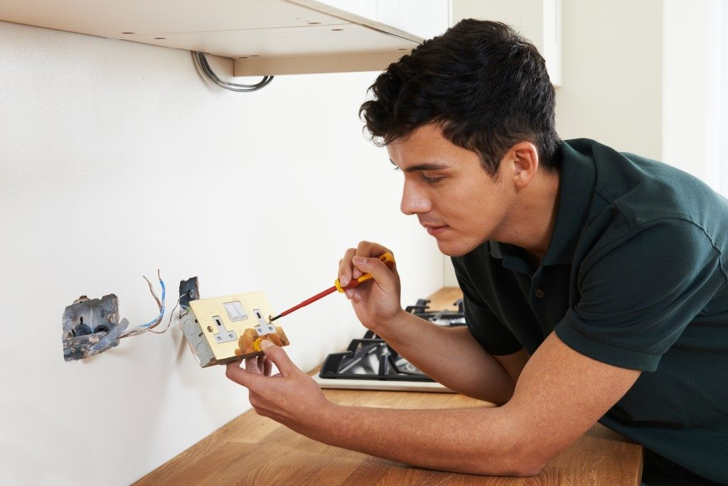 man fixing the wirings at home